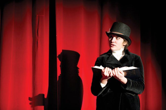 "Charles Dickens, played by Tyanna Zabel, introduces a scene from Hayden Secondary Schools' presentation of  ""A Christmas Carol."" The play will be showing at 7 p.m. today and 1 p.m. and 7 p.m. Saturday."