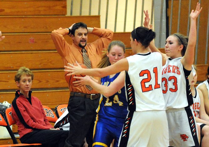 Hayden's Kyra Rolando and Brette Frentress close in on North Park's Aspin Sanchez on Friday en route to a 73-28 victory. Hayden got a turnover on the play when Sanchez couldn't get rid of the ball or break free in five seconds. The Tigers trounced the Wildcats with an intense defense, expanding their lead throughout the game.