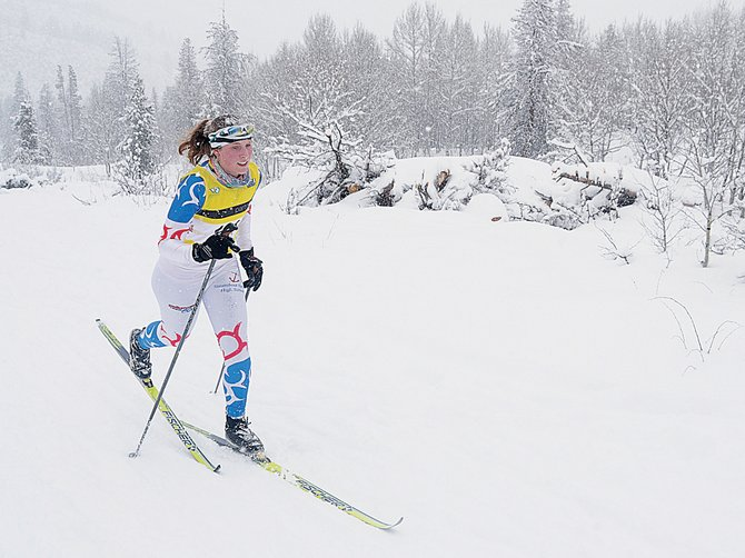 Steamboat Springs High School's Linnea Dixson runs up a hill during the high school Nordic race Saturday at Maloit Park in Minturn.
