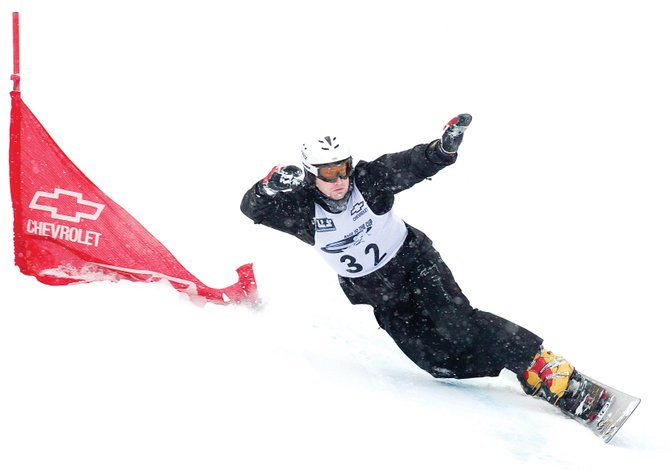 Alpine snowboarder Tyler Jewell, who trained with the Steamboat Springs Winter Sports Club for several years, races down the giant slalom course Monday afternoon during the Race to the Cup snowboarding race at Howelsen Hill.