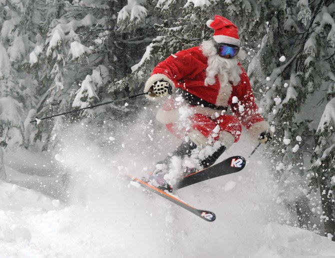 Santa Claus shows off his powder shredding skills Thursday at Steamboat Ski Area. For any children who have last-minute messages, the man in red is scheduled to appear from 11 a.m. to 2 p.m. today on the Routt County Courthouse lawn in downtown Steamboat Springs.