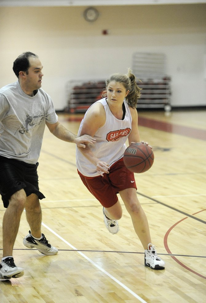 Steamboat Springs High School senior Tara Spitellie drives past coach John Ameen during practice Wednesday. Spitellie is the second-leading scorer this season for the Sailors.