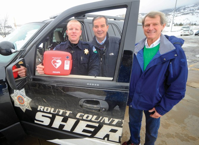 Routt County Sheriff Gary Wall, right, and Undersheriff David Bustos, middle, have been advocating for the purchase of heart defibrillators for all patrol cars. Deputy Clark Kreger, left, and the other deputies now carry them.