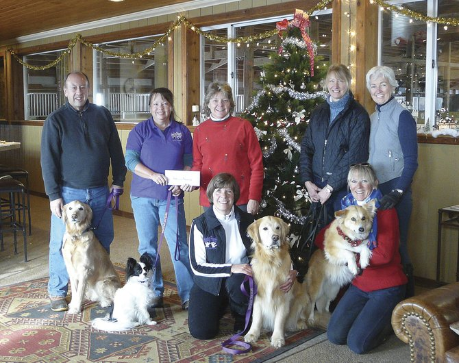 A group of people that board their horses at Sidney Peak Ranch this year got together to raise funds for the Heeling Friends organization. Pictured are, standing from left, Jim Stimson with Bingo, Barbara Cannizzo with Radar, Donna Dunkelberger, Sue Lucas, Janet Finley, and kneeling from left, is Sue Raub with Murphy and Georgiana Stetter with Kateau.