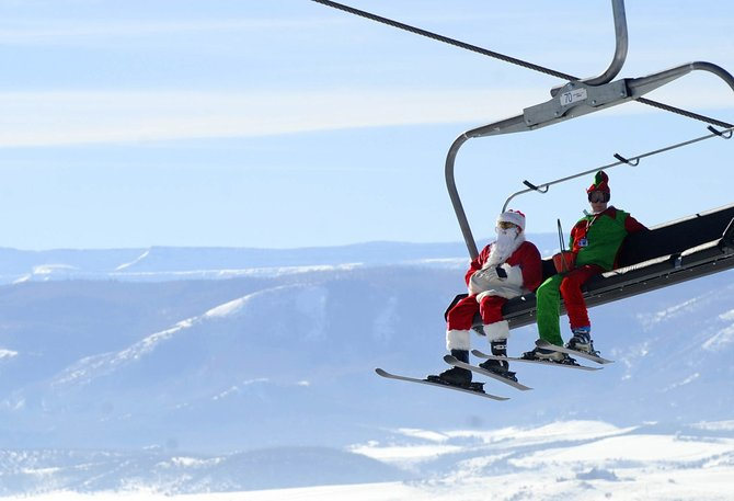 Steamboat Springs residents Tom Dougan and Carolyn Deverell were showing their Christmas spirit on Saturday while riding up the Christie Peak Express lift at Steamboat Ski Area.