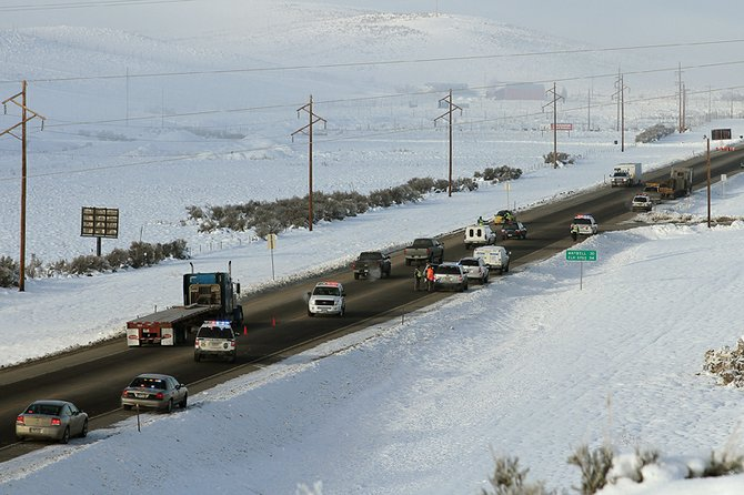Craig Police Department officers help control traffic Tuesday on U.S. Highway 40 as Colorado State Patrol troopers investigate the scene of a semi-trailer accident that killed 34-year-old Justin Dean Bliss, of Craig, near the western city limits of Craig.
