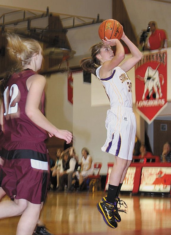 Morgan Wille, a Little Snake River Valley School junior, goes up for a jump shot against Midwest High School on Dec. 20. LSRV girls varsity basketball coach Jodi Stanley credits the teams 7-2 start to solid defense and good shot selection.