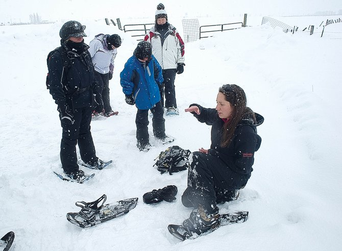 Naturalist Kate Marcos talks about the basics of snowshoeing before leading Yampatika's free family snowshoe tour Wednesday morning. Yampatika recently learned that it would receive funding as part of the state's Colorado Kids Outdoors program.