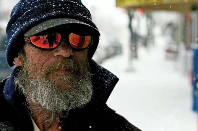 "Clint Durdick, 59, takes a break from shoveling sidewalks Thursday on Yampa Avenue. Durdick, who offers shoveling services, said this week's snow and subzero temperatures amount to ""job security."""