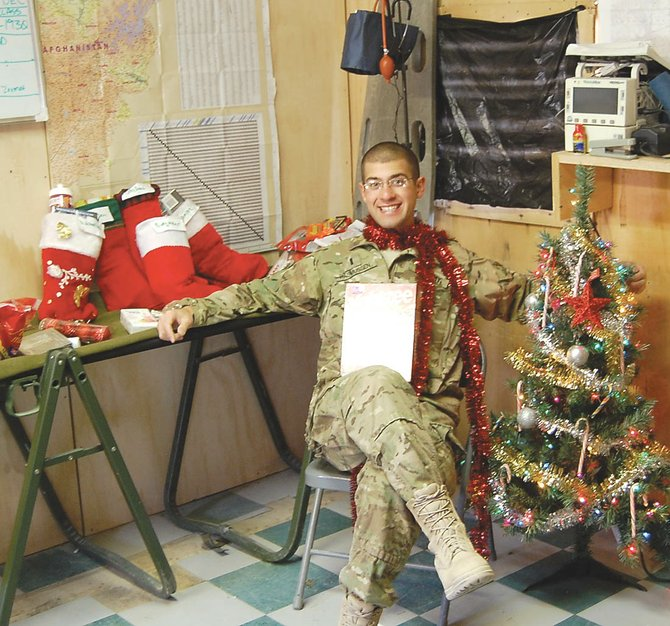 Army 1st Lt. Nicholas Rasmussen, of the Iowa National Guard, shows off some of the holiday cheer from Steamboat Springs he shared with fellow soldiers at a base in Afghanistan.