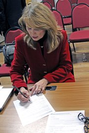 Jean White signs her designation of nomination by the vacancy committee Monday at the Moffat County Courthouse after being selected to replace her husband, Al, in the state senate. Al was recently chosen to lead the Colorado Tourism Office and will step down from the senate on Jan. 11.