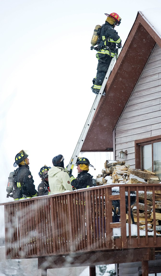 Members of the Steamboat Springs Fire Rescue put out a chimney fire at 1935 Steamboat Boulevard.