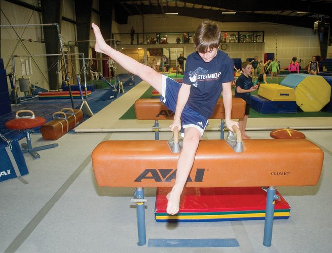 Steamboat Springs gymnast Cole Gibbs warms up on the pommel horse during practice at Excel Gymnastics on Tuesday afternoon. The Steamboat Springs gym will host a men's Junior Olympic competition from noon to 7 p.m. Saturday.