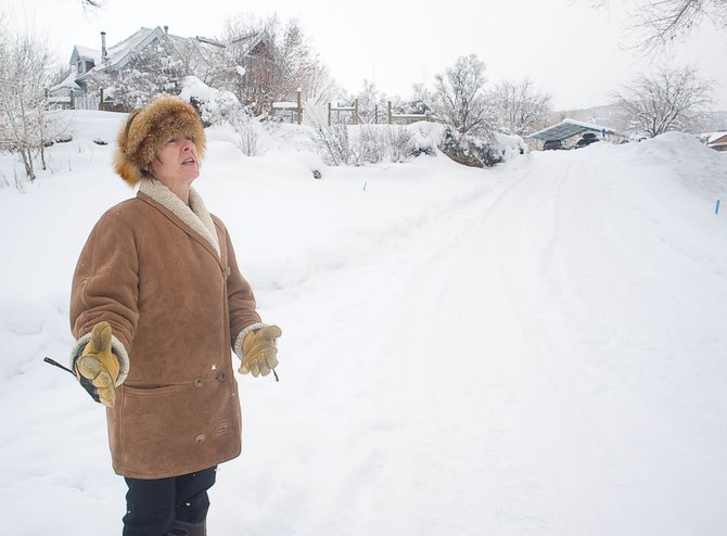 Crawford Avenue resident Sarah Katherman stands at the base of her driveway, which would intersect with an access road if it is approved by the Colorado Mountain College board of directors. Katherman worries the intersection would be unsafe.