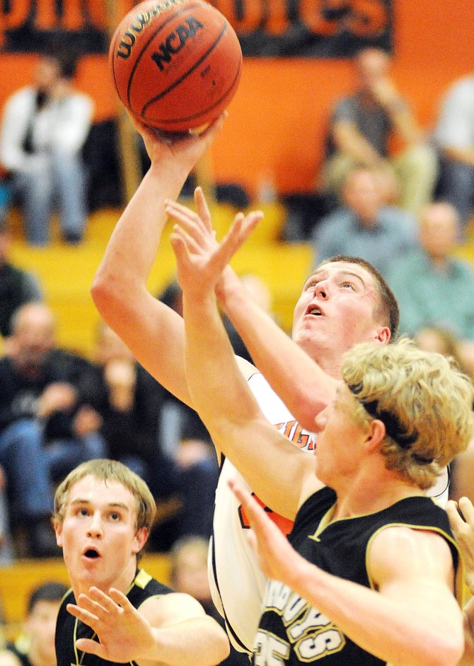 Hayden senior Justin Moon puts up a shot Friday against Meeker. The Tigers won the game, 60-50.