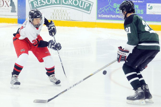 Steamboat's Alex Elliott gets off a shot Saturday during a game in Steamboat Springs. The Sailors beat Summit, 2-1.