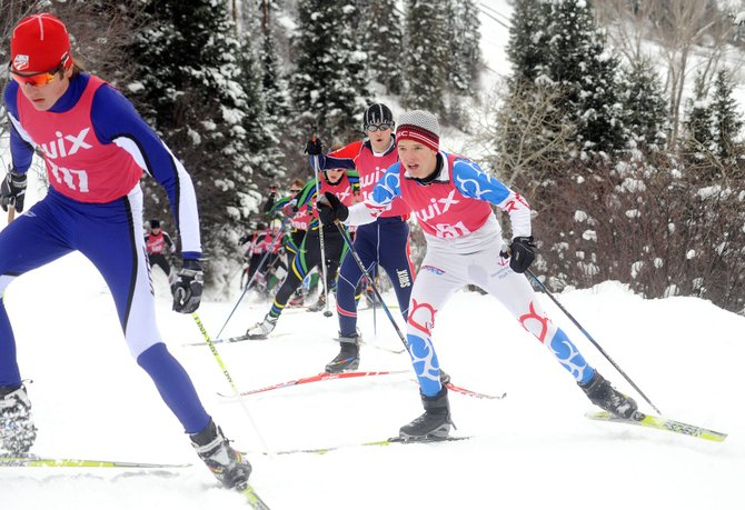 Steamboat Springs High School's Jack Burger, right, charges up a hill Saturday during a high school cross-country ski race in Steamboat. Burger led the Sailors boys team with a 16th-place finish.