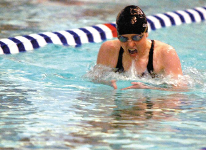 Moffat County High School sophomore Eryn Leonard swims in the third stroke of the 200-meter freestyle race Friday at the Moffat County Invitational. Leonard qualified for state in the race as well as the 100-meter butterfly in leading MCHS to a victory over Aspen.