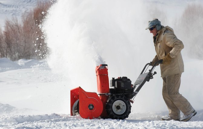 Routt County resident Dean Duryea was bundled up against the frigid conditions Monday morning as he blew snow from the driveway of his home along Routt County Road 14. Duryea said he started blowing snow a little later Monday to allow things to warm up.