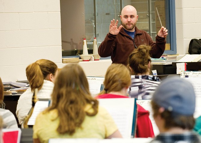 Percussionist Simon Boyar leads the concert band at Steamboat Springs High School on Wednesday morning. Boyar wrote a piece for the band and will perform with them in spring.