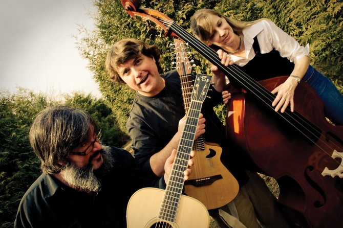 Keller Williams, center, plays a live show at 9 p.m. today at the Sheraton Steamboat Resort. His first set he'll play with bluegrass musicians Larry and Jenny Keel, also pictured. Tickets are $25.