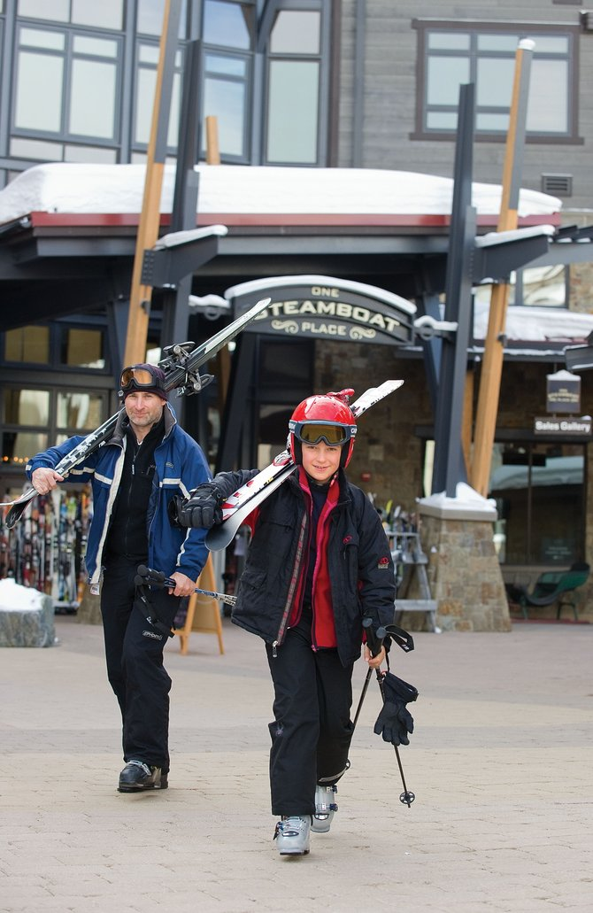 Will and Angus Burns stroll through Gondola Square in front of One Steamboat Place on Thursday morning while vacationing in Steamboat Springs from Australia. Base area businesses are a key component of the local economy. The Steamboat Springs City Council discussed ideas for stimulating the economy during a retreat Thursday.