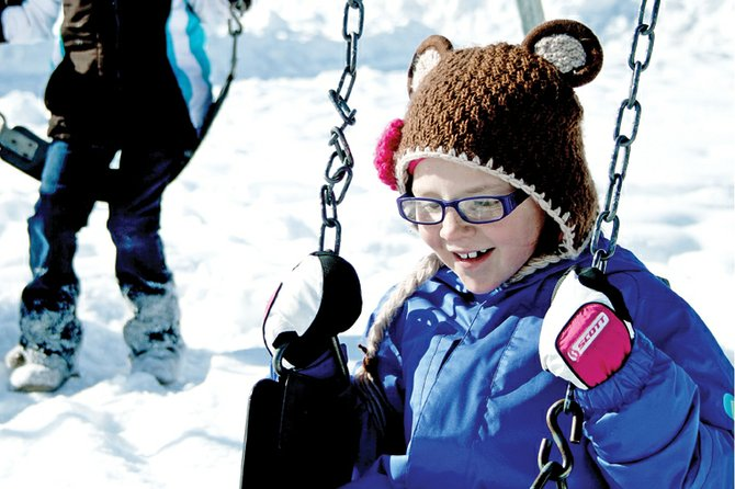 Second-grader Tressa Otis hits the swings during recess Thursday at Ridgeview Elementary School. Earlier this week, students throughout the Moffat County School District had to spend recess indoors due to cold weather. District policy states students must remain indoors when temperatures are 10 degrees or less.