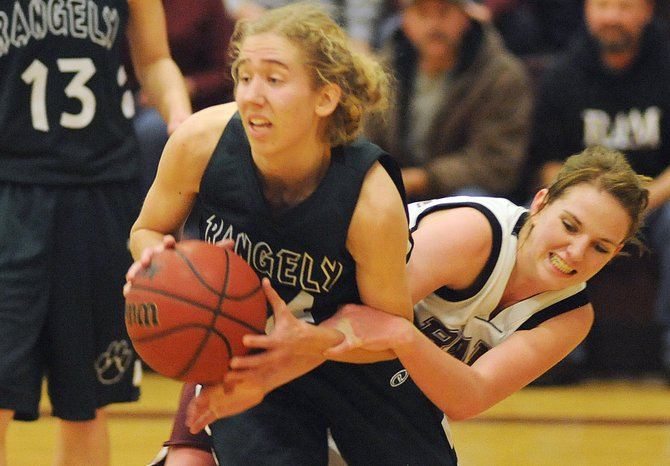 Soroco's Shelby Miles tries to pry a rebound away from a Rangely player on Friday. The Rams lost to the Panthers, 55-43.
