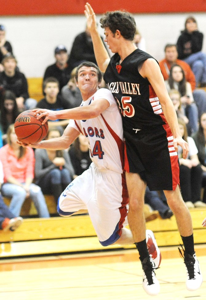 Steamboat's Charles Wood draws a foul as he puts up a shot Saturday as the Sailors beat Eagle Valley, 66-51.