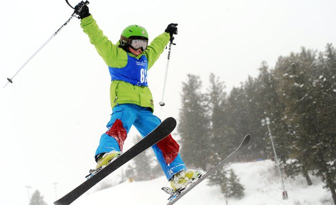 Steamboat skier Landon Wendler flies off a kicker into a spread eagle Sunday during a competition at Howelsen Hill. The event drew more than 100 skiers from across the region.