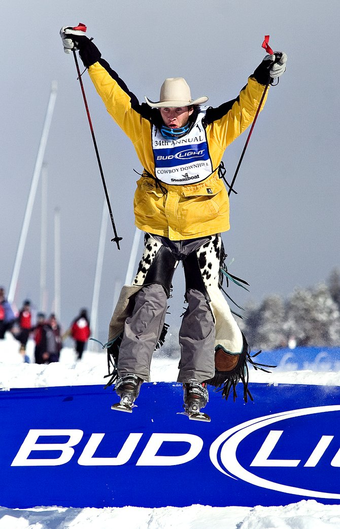 Competitor Jed Moore takes a flying leap off a jump on the Stampede run at Steamboat Ski Area in the 34th annual Bud Light Cowboy Downhill in 2008. This year's event is at 4 p.m. Tuesday.