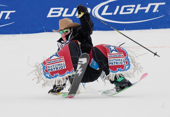Bareback rider Kaycee Field, of Payson, Utah, tries to avoid crashing during the 37th annual Bud Light Cowboy Downhill on Tuesday afternoon at Steamboat Ski Area.
