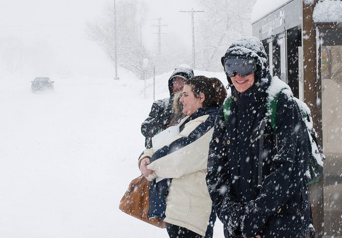 Rebecca Pappas was prepared for the snow Wednesday morning as she waited for a bus in west Steamboat Springs. A winter storm brought heavy snow to the area along with smiles to skiers' faces and a grin from at least one transit rider.