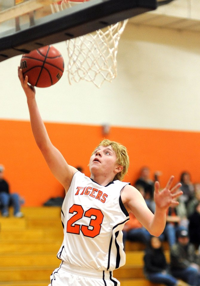 Hayden's Austin Piper goes up for a layup on Friday as the Tigers routed De Beque. The team returns today today against Vail Mountain.