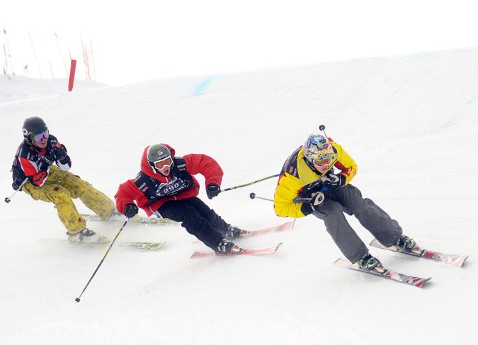 Steamboat Springs skier Stefan Kowynia, right, leads a pack of teammates, Peter White, center, and Logan Banning, left, down the snowboard and ski cross course in Bashor Bowl at Steamboat Ski Area. Five days of competition kick off today at the venue.
