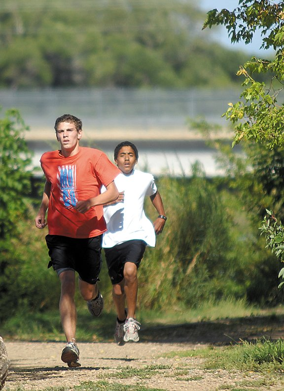Hayden High School senior Chris Zirkle, left, and Moffat County High School junior Alfredo Lebron run through the woods at Loudy-Simpson Park. The pair is expected to pace the MCHS boys cross-country team.