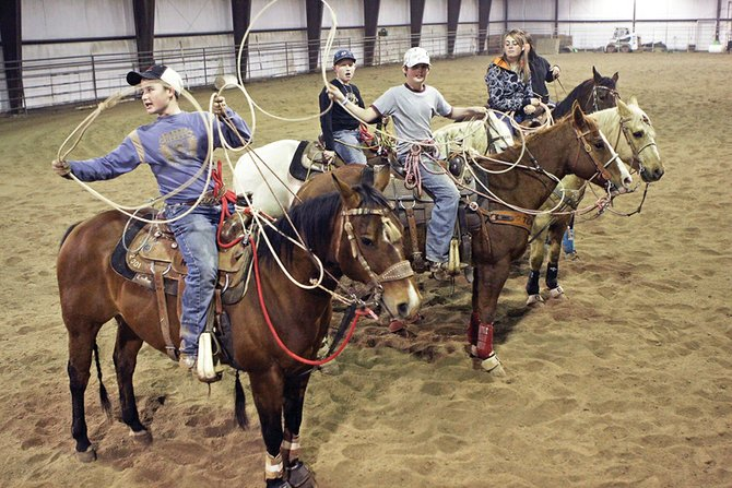 Members of last year's Moffat County High School rodeo team, from left, Casey Barnes, Trent Vernon, Cutter Barnes, Taylor Vernon and Gabbi Steele practice during the winter. The team lost just two seniors — Taylor Vernon and Gabby Miller — in May and are looking to build a foundation on returning and new athletes.