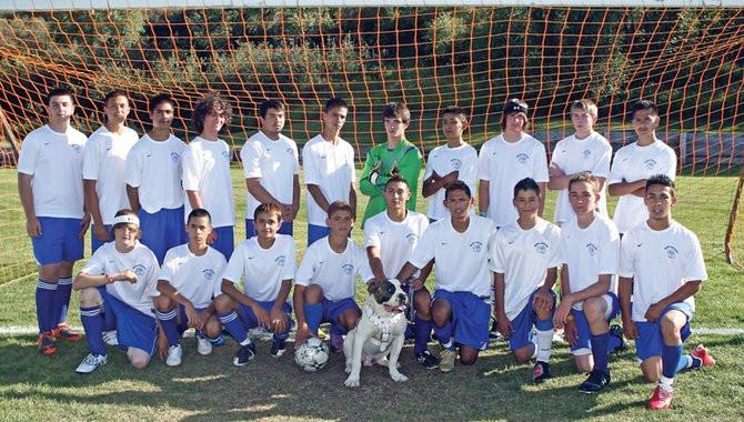 The Moffat County High School boys varsity soccer team took a step forward in 2009, and coach Rusty Cox expects a bigger step in 2010. The team is, back row from left, Adrian Hernandez, Jonathan Pando, Manuel Tarango, Eli Voyich, Inez Quezada, Tracy Mendoza, Dustin Carlson, Johnny Landa, Keegan Welder, Brandon Duncan and Victor Villa. In the front row, from left, is Ben Booth, Jorge Gonzalez, Erik Silva, Alan Flores, Favian Quezada, Alex Perez, Nestor Arellano, Bryant Cox and Lupe Rodriguez. The team's mascot, Torro the American Bulldog, is pictured front and center. Not Pictured: Cody Fallon and Jorge Torres.