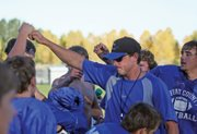 Kip Hafey, Moffat County High School head football coach, brings his team together after practice Wednesday at MCHS. The Bulldogs wrapped up their last day of full contact practice for the week in preparation for tonights Homecoming game against Palisade High School. Hafey has a 6-2 career record on Homecoming at MCHS, although his teams have struggled against Palisade.