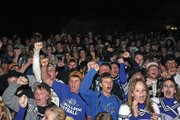 Moffat County High School spirit and football team members led the crowd in singing the school victory song as a bonfire was lit Thursday night behind the school. A pep rally preceded the bonfire to encourage class pride and school spirit.