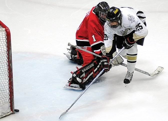 Steamboat Springs' goalie Joey Haight, left, blocks Battle Mountain's Summers Baker from scoring a point Saturday at the Dobson Ice Arena in Vail. Battle Mountain won, 5-2.