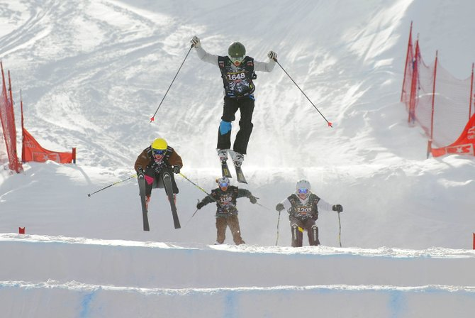 Steamboat Springs skiers Maggie McElhiney, right, Jaelin Kauf, middle top, and Lesley Wilson, left, compete with Crested Butte skier Josie Byron during Saturday's ski cross event at Steamboat Ski Area.