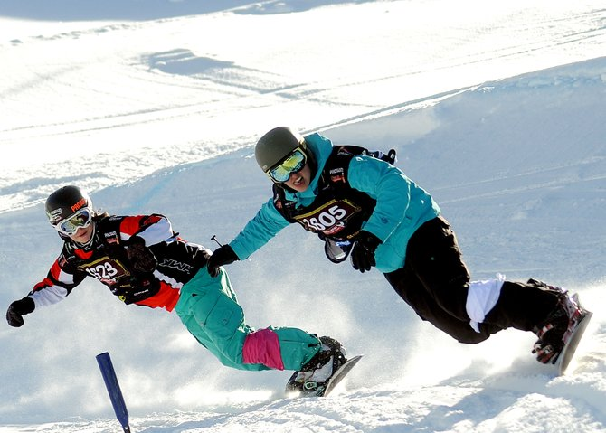 Jenna Feldman, right, holds a narrow lead on Chloe Banning during Sunday's USASA snowboard cross event in Steamboat Springs. Banning went on to pass Feldman on the course at Steamboat Ski Area, but the pair, both Steamboat riders, finished first and second in the women's open class.