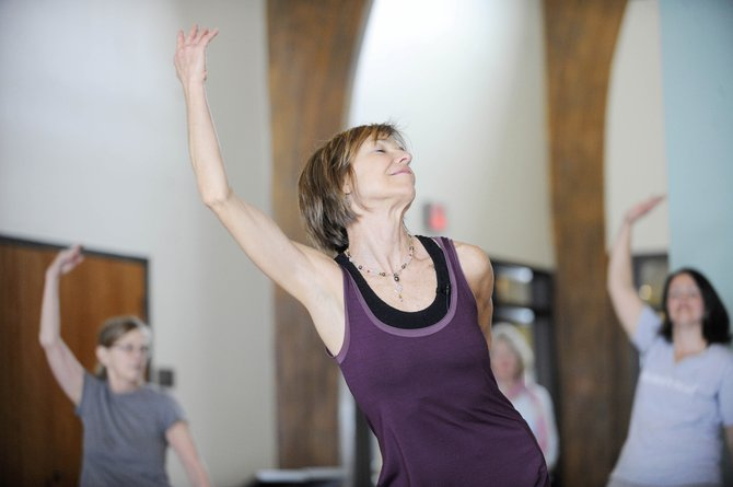 Patty Zimmer leads a Yogatta Dance class Saturday during Yoga Day USA at Bud Werner Memorial Library.
