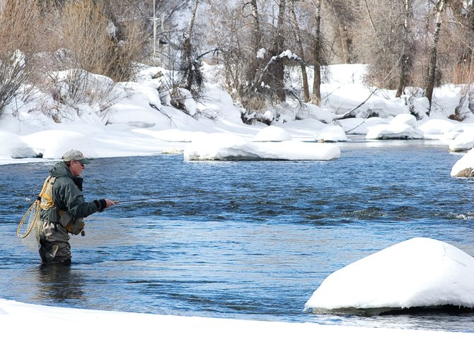 Steamboat Springs resident Wally Cerise tests the waters of the Yampa River on Monday afternoon. City and Mount Werner Water and Sanitation District officials have created a water conservation plan, with long-term conservation goals. They are accepting public comment through Feb. 23.