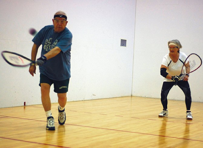Bill Muldoon, left, serves during a recent game of racquetball with Sue Eschen at Trapper Fitness Center. Muldoon, a 75-year-old Craig resident, and Eschen, 63, both placed fourth at the World Senior Games in Utah, qualifying them for the Senior National Racquetball Championships in June in Houston.