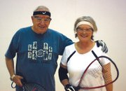 Bill Muldoon, left, stands with his arm around Sue Eschen at Trapper Fitness Center. Muldoon and Eschen, along with their friend Barb Gregorie, are teaching a senior racquetball clinic this month to help seniors get exercise and work on agility and hand-eye coordination.