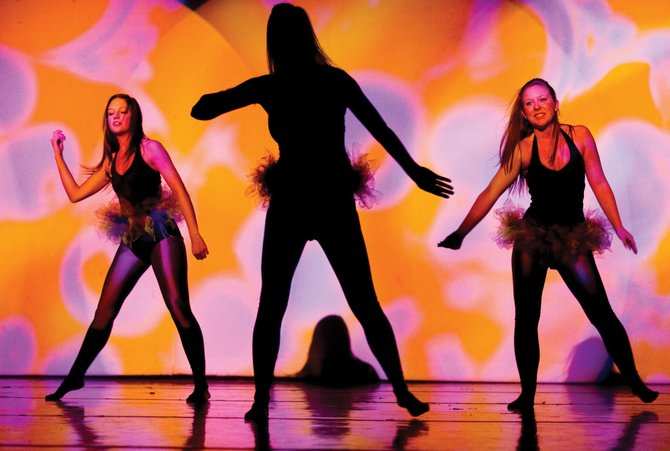 Steamboat Springs High School students, from left, Hannah Ogden, Kate Rusk and Catherine Fischer perform during a rehearsal for the 15th annual Dance Showcase on Tuesday evening in the high school auditorium. The show will open at 7 p.m. Thursday.