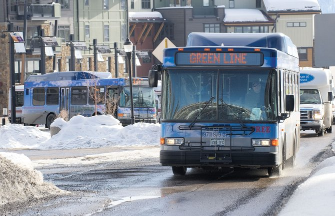 A Steamboat Springs Transit hybrid bus pulls out of the Gondola Transit Center on Thursday afternoon. The city is planning to use state transportation grants to help purchase two new hybrid buses, which would bring the city's total to five.
