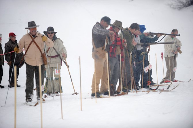International Muzzle Loading Biathlon participants line up to shoot during the annual event at Howelsen Hill. Competitors wear vintage attire in the event that features cross-country skiing and marksmanship with black powder rifles. Spectators are encouraged for the competition, which is from noon to 2 p.m. Feb. 5 at Howelsen Hill.